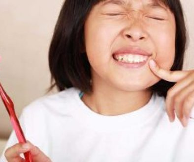 child with tooth pain